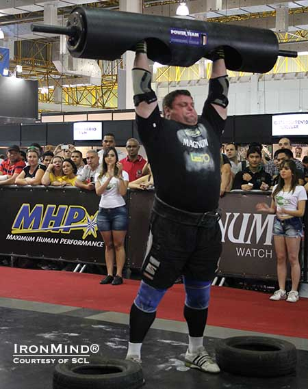 Zydrunas Savickas on the Log Lift for reps at the MHP Strongman Champions League competition held at the Expo Nutrition in Sao Paulo, Brazil.  IronMind® | Image courtesy of SCL