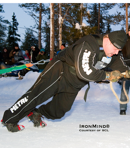 Strongman competitors routinely use rock climbing shoes for added traction on the truck pull, so when there's snow and ice underfoot, they switch over to crampons.  IronMind® | Courtesy of Strongman Champions League.