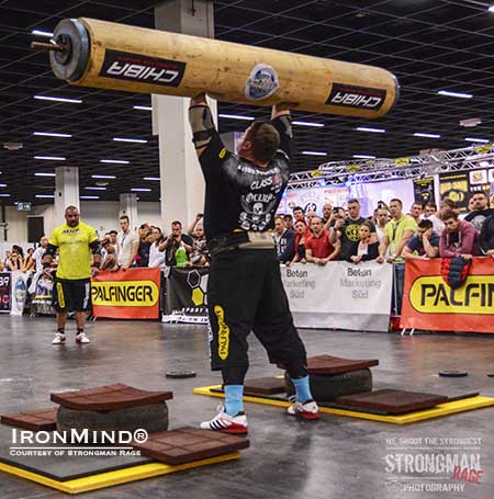 The Log Lift King, Zydrunas Savickas, doing his thing at the FIBO.  IronMind® | Photo courtesy of Strongman Rage