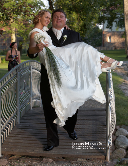 Cross training or is this just another time when it makes life easy to be a World's Strongest Man winner?  Zydrunas Savickas makes light work of carrying his bride, Jurgita, over a bridge.  IronMind® | Photo courtesy of Zydrunas Savickas.