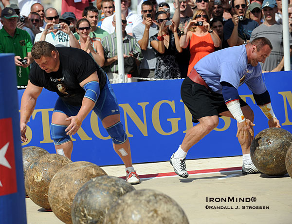 Zydrunas Savickas and Mariusz Pudzianowski in the last event at the 2009 World's Strongest Man contest.  IronMind® | Randall J. Strossen photo.