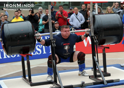 Zydrunas Savickas, the defending champion, looked powerful as he squatted for reps at the MET-Rx World's Strongest Man contest today.  The competitors had to touch the the spotter racks, which were set for what was a legal bottom position, on each rep.  IronMind® | Randall J. Strossen photo.