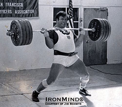 "Bruce Wilhelm's PR power clean of 210 kg.  Jim Schmitz calls it ""an ugly lift, but it was strong and impressive.""  IronMind 