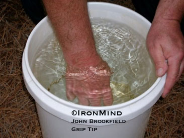 Drive your hand into the water (above) and then open it explosively for improved grip strength and hand health.  ©IronMind/John Brookfield Grip Tip.