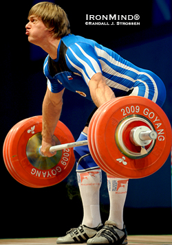 Dmitri Lapikov (Russia) smoked this 191-kg snatch in the 105s at the 2009 World Weightlifting Championships.  Using straps wisely in training helps increase your top lifts in competition.  IronMind® | Randall J. Strossen photo.