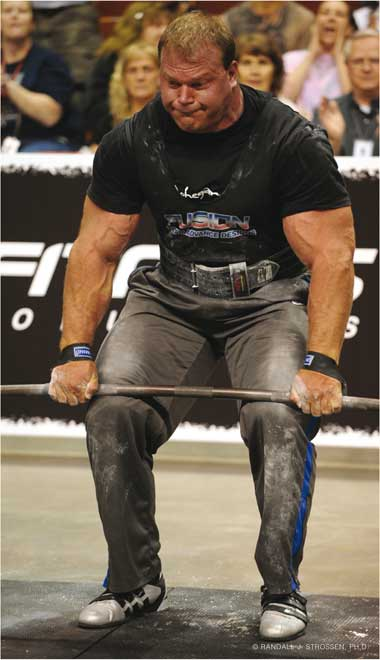 Derek Poundstone (three-peating at the Super Series Mohegan Sun) was in the beta test when IronMind developed Blue Twos Lifting Straps and Black and Fourth Lifting Straps. Derek gave us valuable feedback as he latched onto the Black and Fourth Lifting Straps . . . that's his original pair of prototype Black and Fourth Lifting Straps in the photo. Randall J. Strossen photo.