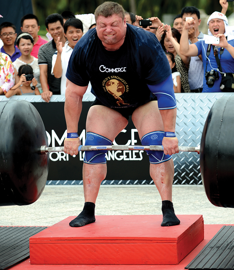 Zydrunas Savickas using Strong-Enough Lifting Straps on the Car Deadlift at the 2010 World's Strongest Man competition in Sun City, Africa. Randall J. Strossen photo.